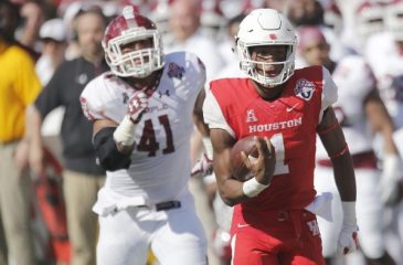 Houston quarterback Greg Ward Jr. rushes in for a touchdown during the first half. Photo via Thomas B. Shea/USA TODAY Sports.