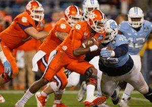 Clemson's DeShaun Watson attempts to run through a North Carolina defender. Photo via tackleo.com.