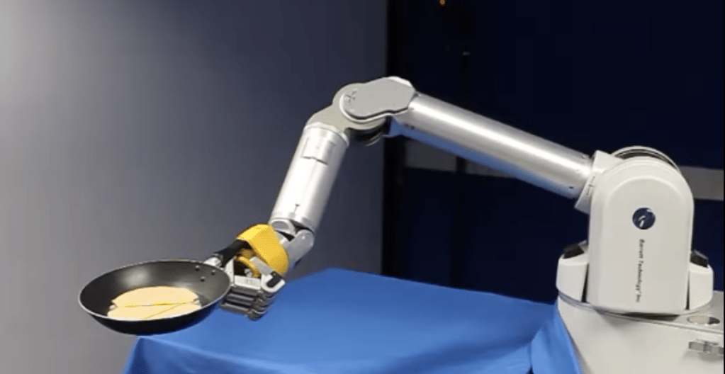 A robot arm learns to flip pancakes