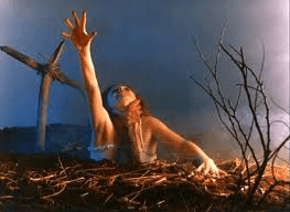"""""""Evil Dead 2""""  This scene shows a classic depiction of bone-chilling horror."""