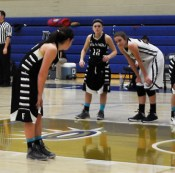 A Finlandia player faces off against forward Taylor Baumgart. She averaged 31.6 minutes per game.