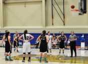 Sophomore forward Donielle Yondriga (hidden) drops a free throw. She shot 17 points with 13 rebounds.