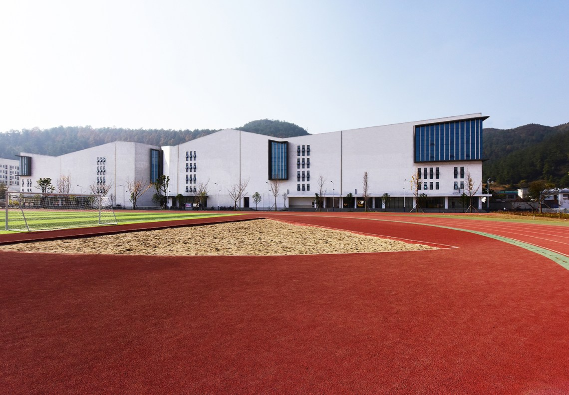 White Facade of the Dushan School Complex by West-line studio
