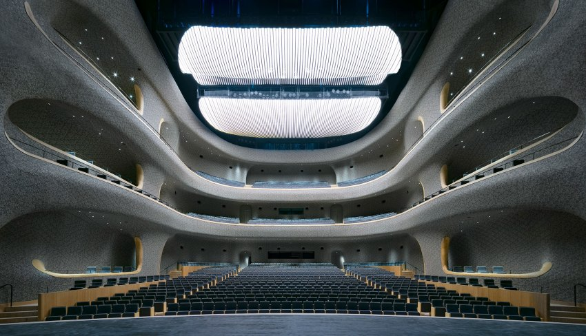 The Opera Hall is designed for a 1600 seat audience. The shape is fully generated with the help of acoustic scripting tools, and the complex 3000m2 double-curved surface is clad with about 1.5 million custom developed ceramic tiles.