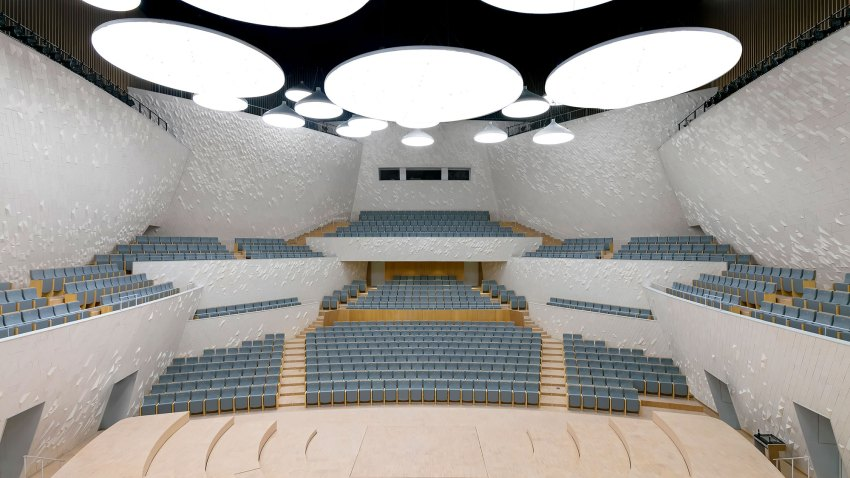 The Concert Hall is designed for a 1000 seat audience. Its walls are in the large scale composed of fractions of sphere surfaces, facing the audience seating area, and providing for the most functional acoustical shaping of the room