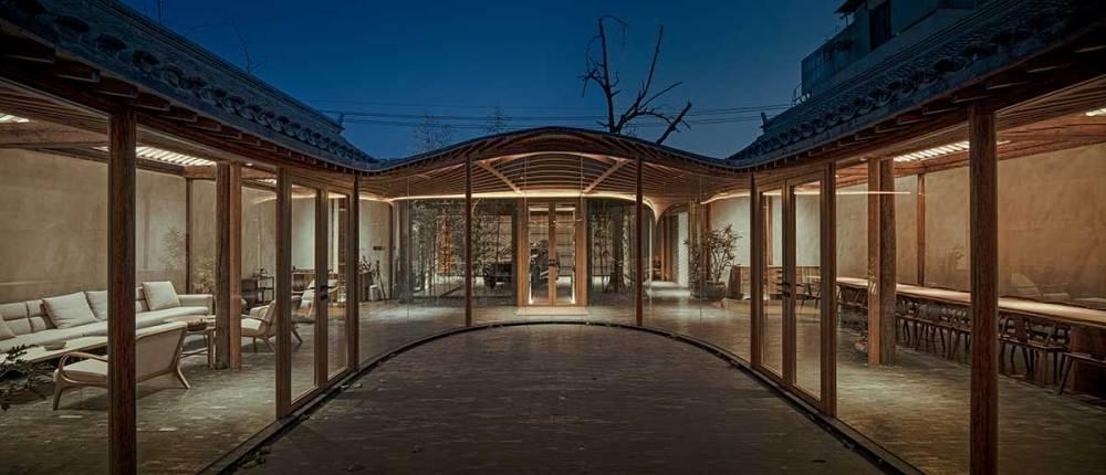 Middle courtyard night view - Qishe Courtyard in Beijing / ARCHSTUDIO