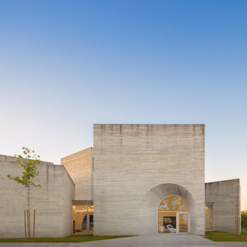 Stone Facade with Arch Entrance - Interpretation Centre of Romanesque Exhibition Centre by spaceworkers