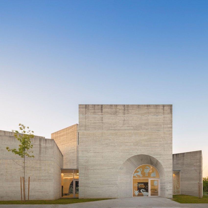 Stone Facade with Arch Entrance - Interpretation Centre of Romanesque Exhibition Centre byspaceworkers