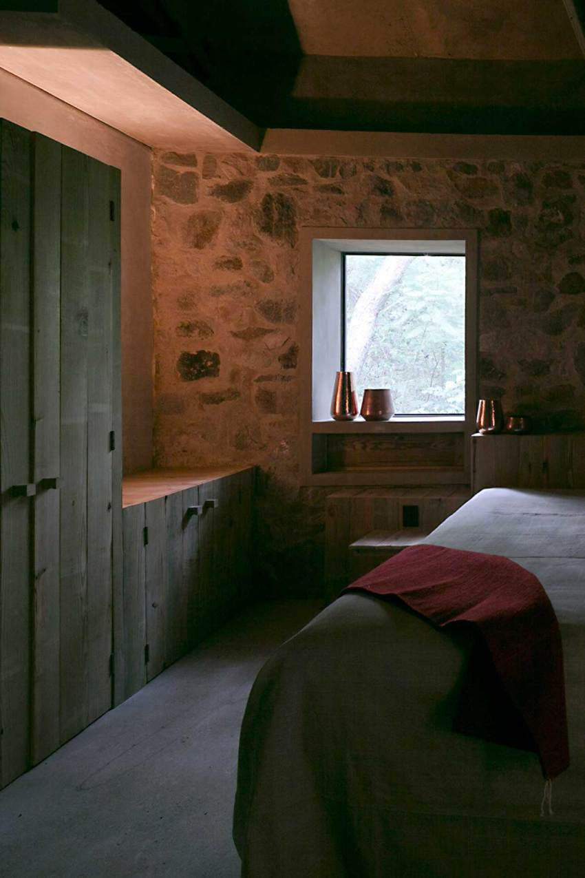 Stone walls in modern rural house in bedroom space