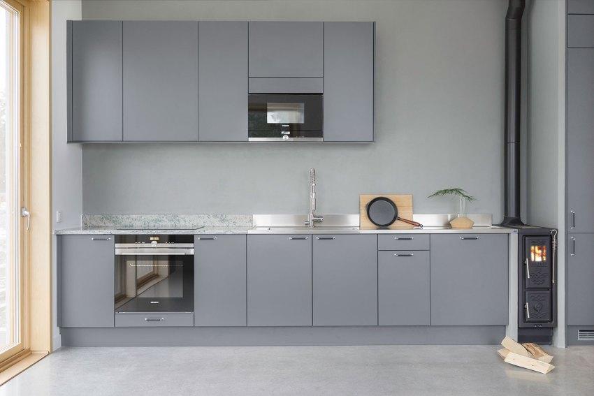 Blue Kitchen - Brf Ferdinand Dwellings in Aspudden / Scott Rasmusson Källander