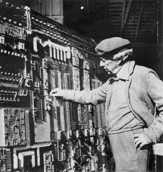 Frank Lloyd Wright inspecting model