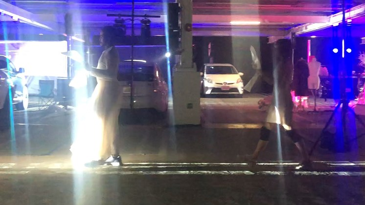 Acting and singing on the parking