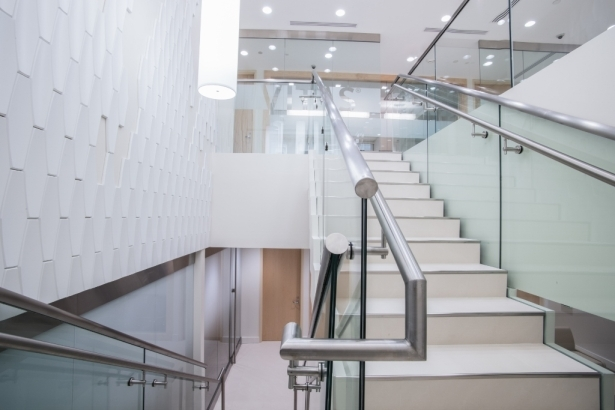 Commercial Staircase Design – Vitas Headquarters Bella Stairs | Staircase Design For Commercial Buildings | Cylindrical Glass | Enclosed | Beautiful | Central Staircase | Sleek