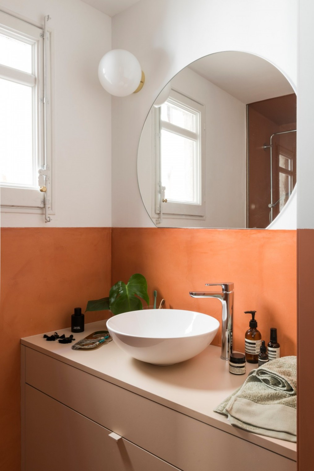 pThe bathroom has the same microcement feature as the kitchen backsplash and its terracotta and blush shades tie in with...
