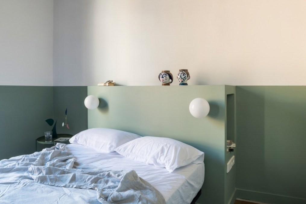 pIn the master bedroom a clever storage nook was built in the custom headboard.p