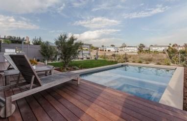 Ipe deck overhangs pool deck for easy access