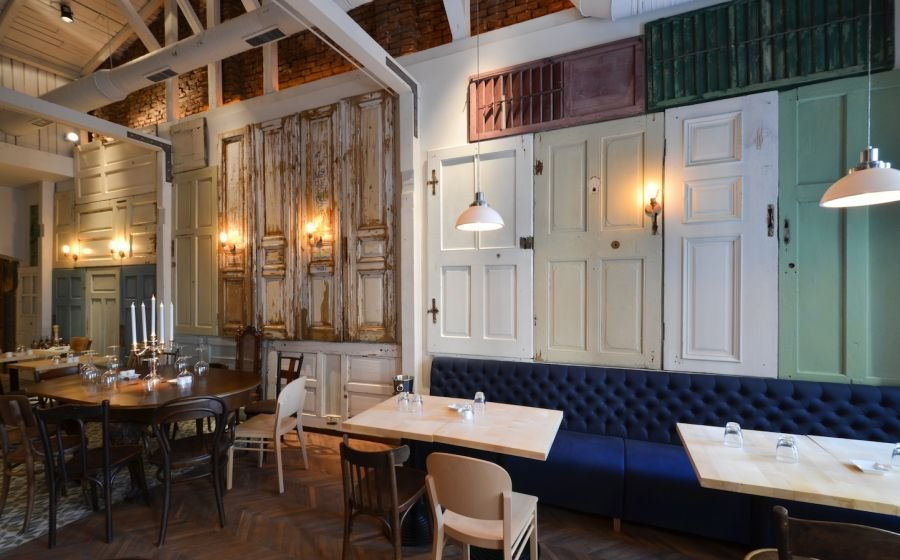 Restaurant Interior Made out of Salvaged Doors  Windows