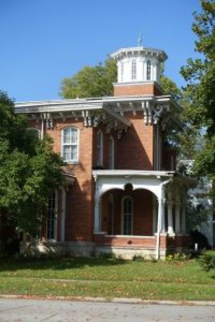 Only the lower (balustrade-height) section of this Italianate porch was altered when brick was utilized to simplify its appearance it in the early 20th century. It is probable that the original wood columns either continued to the porch floor or rested upon wood pedestals. A low wood balustrade may have also been present.