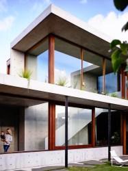 concrete architecture auhaus torquay australia wood pad architects captivating combination warm courtyard reveal golf homes sheltering internal designboom est living
