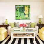 Black And White Striped Rug With Abstract Artwork And Furniture That Matches Said Artwork With Pillow