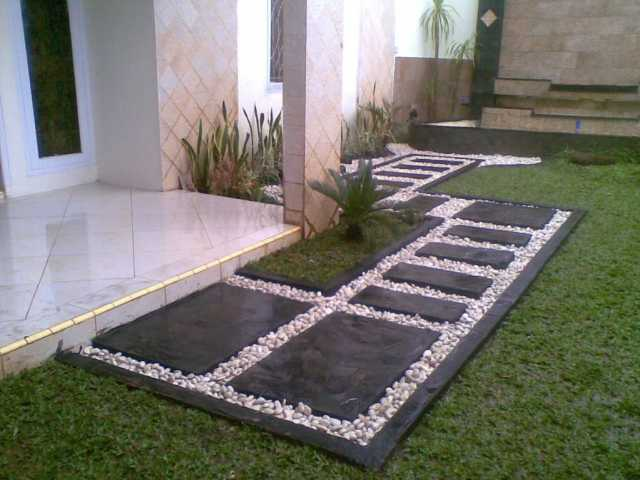 Natural Stone Fist And Green Grass For Unique Terrace