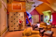A Spacious Loft With Tall Ceiling Accommodated A Climbing Wall And Welcomed A Colorful Layout