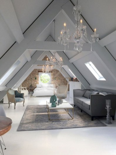 Attic Bedroom With Beautiful Chandeliers With Large Ceilings