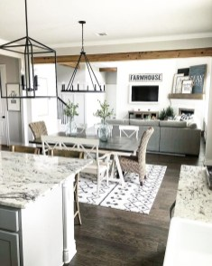 Farmhouse Style Open Layout With Kitchen, Dining Room And Living Room