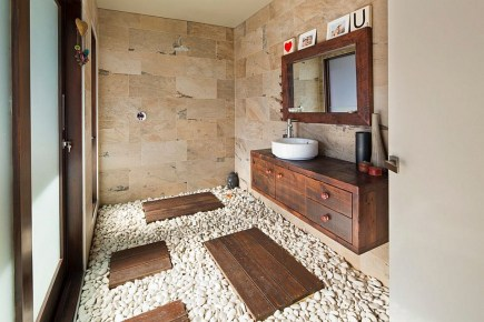 Natural Stone And Pebbles Create An Exotic Tropical Style Bathroom