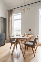 White And Light Brown Dining Room In Apartment