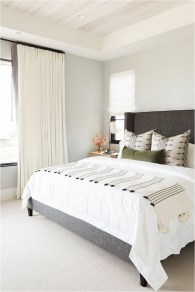 White Main Bedroom In Apartment