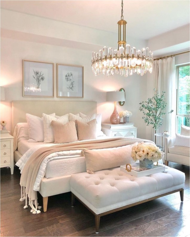 Soft Pink Bedroom With White Ottomans