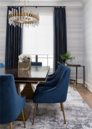Modern Navy Dining Room With Modern Pendant