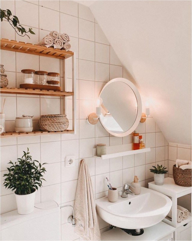 Pink Lightning Bathroom With Bamboo Rack