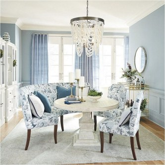 Soft Blue Dining Room With Floral Chairs