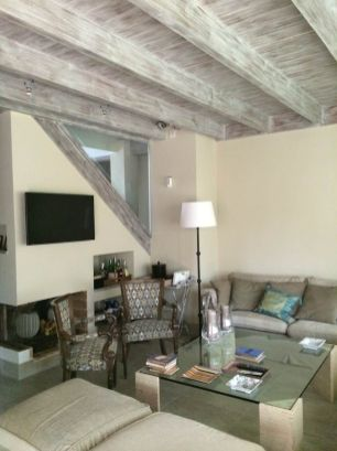 Outdated Finishing for Unique Ceiling Design with Wooden Beams