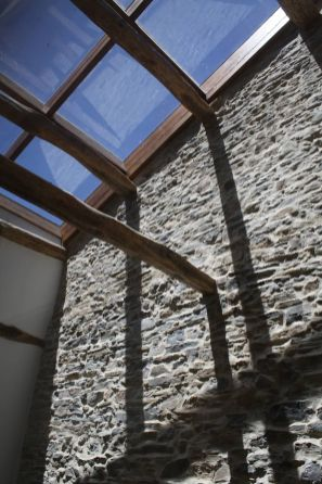 Wood Beams and Glass for Unique Ceiling Design with Wooden Beams