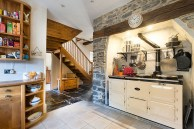 Custom Kitchen Design With Exposed Stone Feature And Small Workstation [From Colin Cadle Photography]