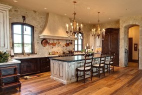 Mediterranean Kitchen With An Exquisite Stone Wall Backdrop [Design Pyramid Builders]