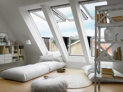 Attic Bedroom With Large Windows That Have A View Over The Beautiful Sky