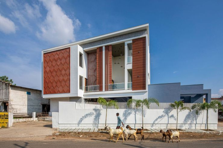 Clay roof tiles façade to minimize heat gain and has decorative function, at Vadodara, by Manoj Patel Design Studio 1