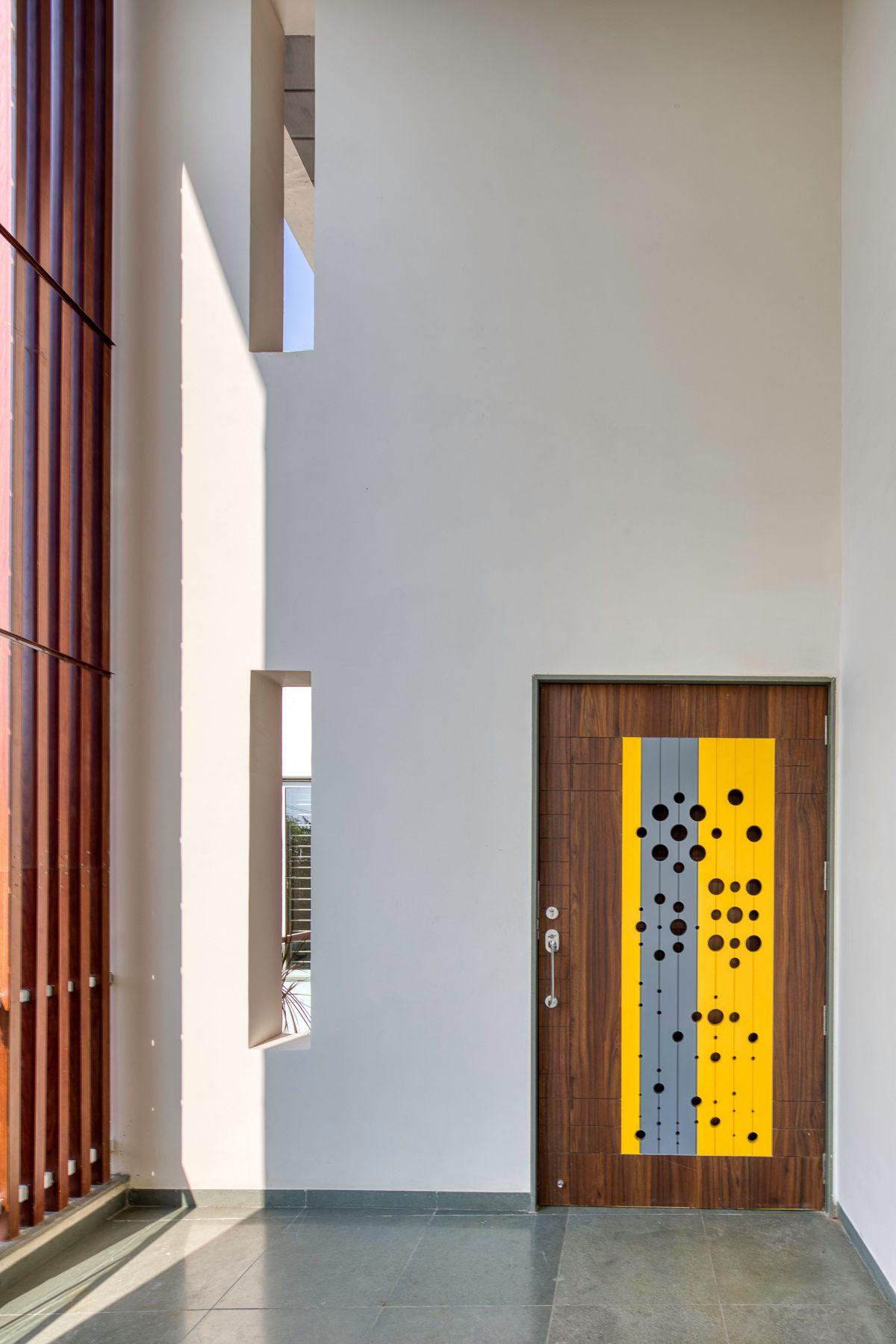 Clay roof tiles façade to minimize heat gain and has decorative function, at Vadodara, by Manoj Patel Design Studio 31