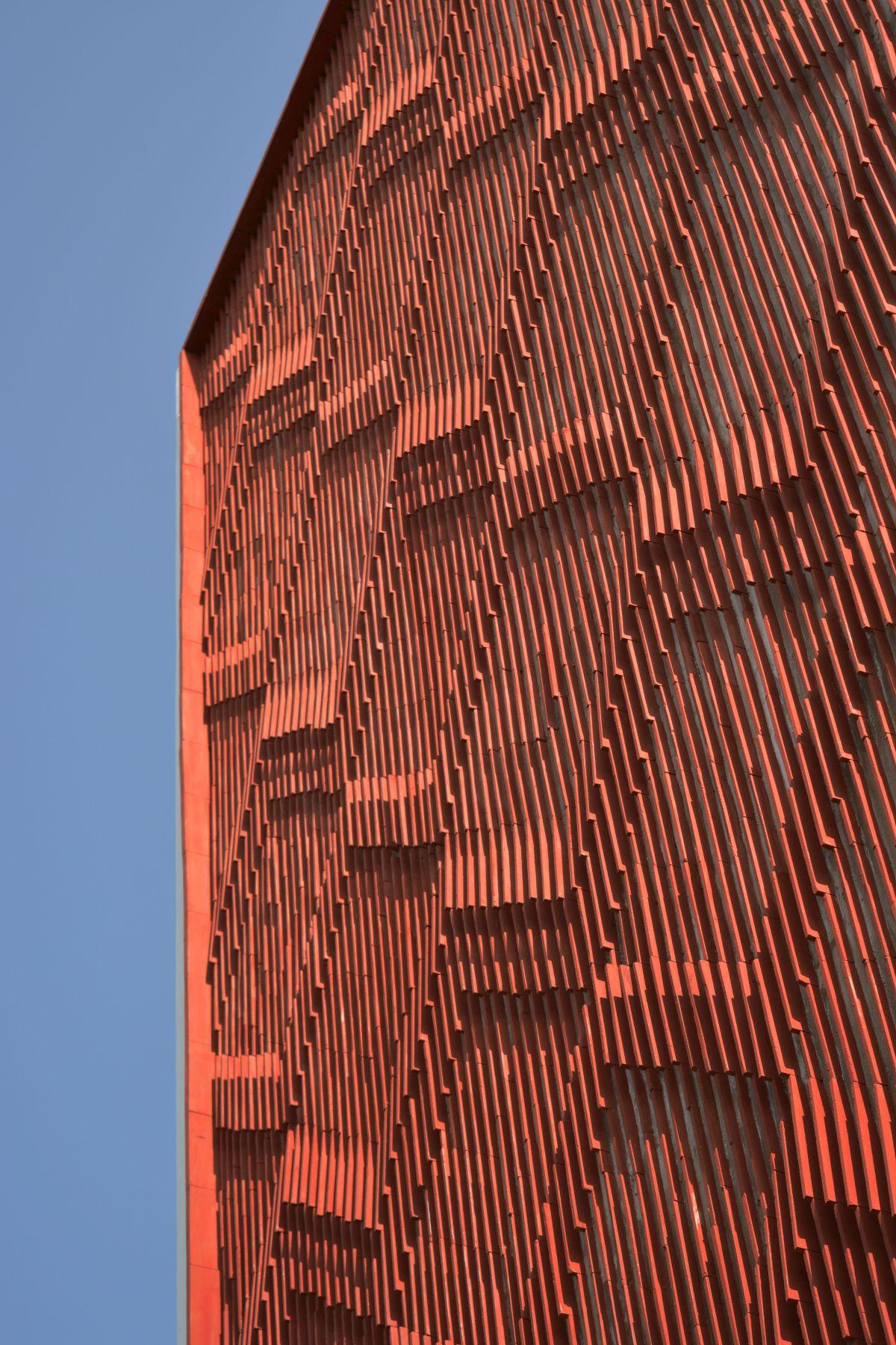 Clay roof tiles façade to minimize heat gain and has decorative function, at Vadodara, by Manoj Patel Design Studio 72