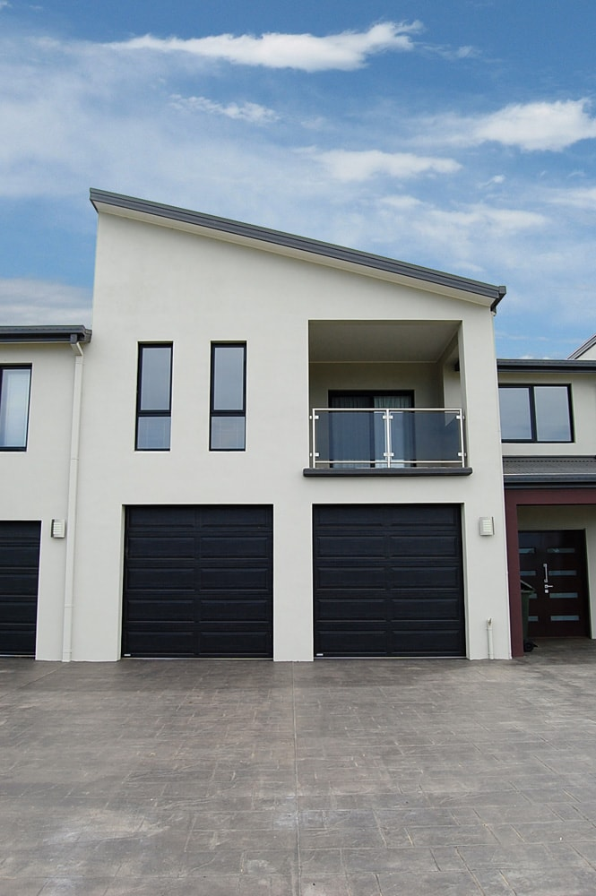 Architecture Republic designed rendered townhouses - garage and driveway view