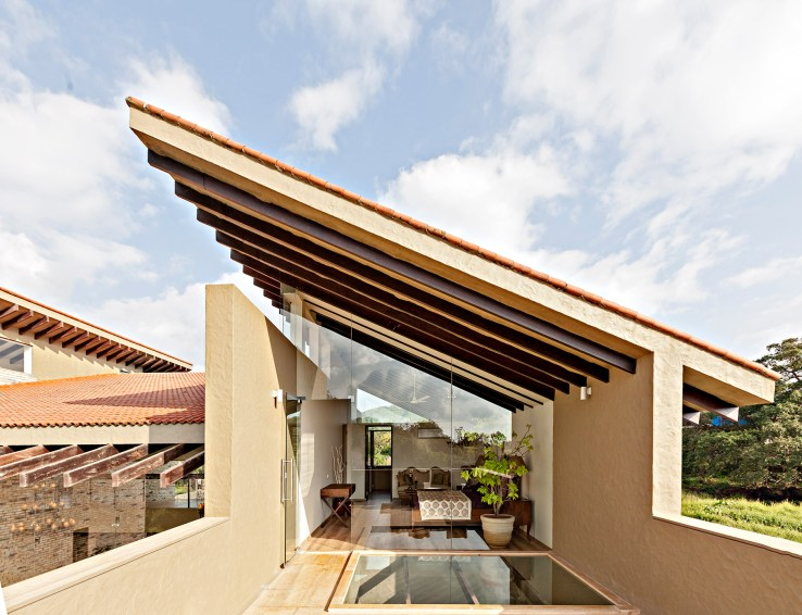 139626541279517 The Master Bedroom blurs the boundary between indoors and outdoors opening onto a private terrace with a walk on glass skylight over the dining courtyard