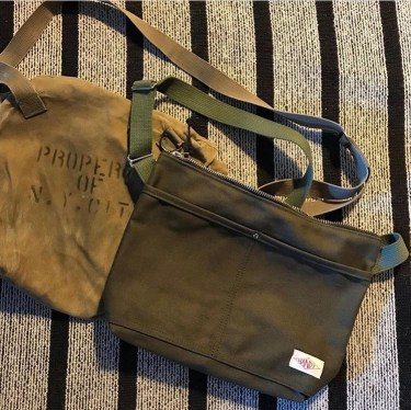 Vintage canvas bag and modern Handy bag