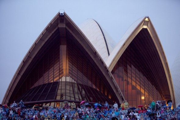 Wet punters beneath the Opera House sails for Rogues Gallery