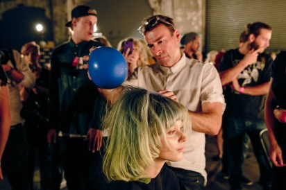 Alan White for ghd uses the static from a balloon to get the hair messed just right