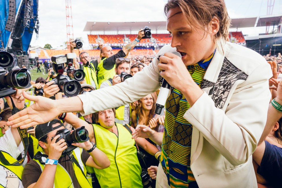 Win Butler of Arcade Fire greets fans and photographers