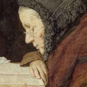 elderly woman reading the bible